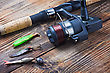 Fishing Tackle On A Wooden Table stock photography