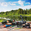 Fishing Tackle On A Pontoon On The Background Of The Lake In The Woods stock photo
