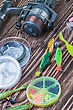 Fishing Tackle Spinning On A Wooden Table stock photo