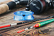 Fishing Tackle On A Wooden Table. Focus On The Front Of The Fishing Float stock photo