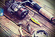 Fishing Tackle On A Wooden Table. Toned Image stock photo
