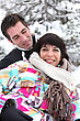 Flirtatious Couple Playing In The Snow