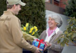 Florist Delivering Flowers & Gifts stock photo