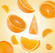 Flying Sliced Orange Fruit Segments Background stock image