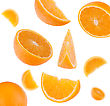 Flying Sliced Orange Fruit Segments Isolated On White Background stock photo