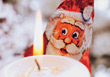 Foiled Covered Chocolate Santa & Candle stock photo