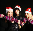 Expressions Four 20-25 Years Women Friends Having Fun On A Christmas Party stock photo