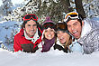 Four Friends Laying In The Snow stock image
