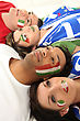 Four Italian Soccer Fans Laying On The Floor stock image