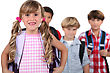 Four Young Children With Backpacks stock photo