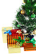 Fragment Of Christmas And New Year Tree With Gift Boxes. Isolated Over White Background