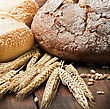 Fresh Bread And Rolls With Ears Of Wheat On The Table stock image