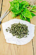 Fresh Green Basil And Dry On Paper, Scissors, Ball Of Twine On A Wooden Boards Background stock image