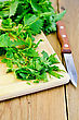 Stinging Fresh Green Nettle Incised On A Wooden Board With A Knife stock photography