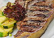 Fresh And Juicy T-bone Steak With Vegetables
