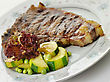 Vegetables Fresh And Juicy T-bone Steak With Vegetables stock photo