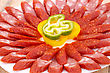 Fresh Sausages And Peppers In Plate On Bamboo Mat Background