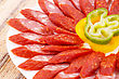 Fresh Sausages And Peppers In Plate On Bamboo Mat Background stock photography