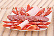 Sausages Fresh Sausages In Plate On Bamboo Mat Background stock photography