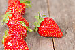 Fresh Strawberries In A Row On Wooden Background stock photo