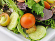 Fresh Vegetable Salad On A White Dish, Close Up