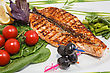 Freshly Cooked Fish And Fresh Vegetables On The Plate stock photo