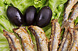 Fried Anchovies On Lettuce Leaves With Olives stock photography