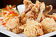 Fried Chicken Wings Garnished With Fresh Vegetables With Teriyaki Sauce stock photography