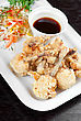 Appetizers Fried Chicken Wings Garnished With Fresh Vegetables With Teriyaki Sauce stock photo