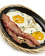 Fried Eggs And Bacon In A Skillet stock photography