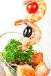 Fried Kebab Of Shrimps With Vegetables, Greens And Salmon Fish stock photography