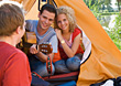 Friends Camping & Playing Guitar stock photography