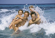 Friends Having Fun In Ocean Waves stock photography