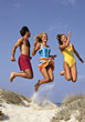 Friends Jumping High stock image