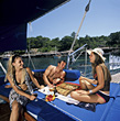 Friends Relaxing on Boat stock image