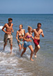Friends Running On The Beach stock photo