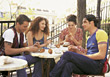 Friends Sitting at Outdoor Restaurant stock photography