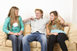 Friends Sitting on Couch Talking