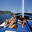 Friends Tanning on Sailboat stock photo