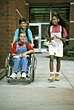 Children Friends with Girl in Wheelchair stock image
