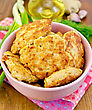 Fritters Minced Chicken In A Pink Bowl, Napkin, Oil, Dill, Garlic, Ginger, Green Onions On A Wooden Board stock image