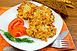 Fritters Of Minced Chicken On A White Plate With Tomato And Dill, Knife, Fork, Napkin Orange, Rye Bread On A Wooden Board stock photo