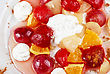 Fruit Salad Of Pineapple, Grape, Orange And Strawberry With Whipped Cream stock photo