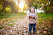 Autumn Funny Little 2 Year Old Kid Laughing And Walking In The Park At The Sunset With Toy In His Hand. Happy Childhood Concept stock photography