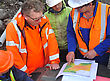 Geologists Discuss The Oil-bearing Formation Being Explored In A Seismic Reflective Survey On The West Coast Of New Zealand stock image
