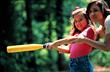 Girl and Mom Playing Softball stock image