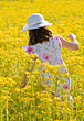 Girl Dressed up in a Flower Field stock photo