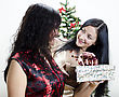 Girl Gives Another Girl A Gift For Christmas stock photography