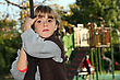 Girl Holding Onto A Rope In A Playground stock photo