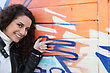 Girl In Front Of Graffiti Wall stock photo